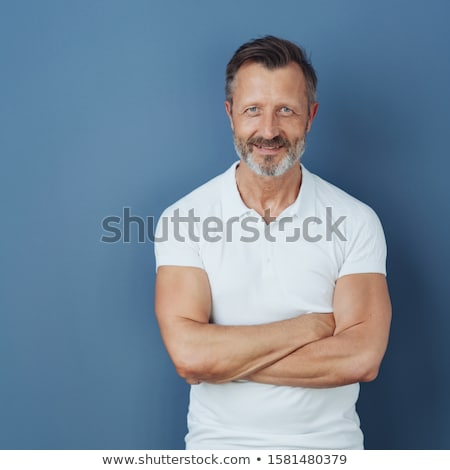 middle-aged man relaxing against blue background Stock photo © photography33