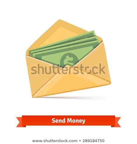 Put dollars bills on the envelope stock photo © broker