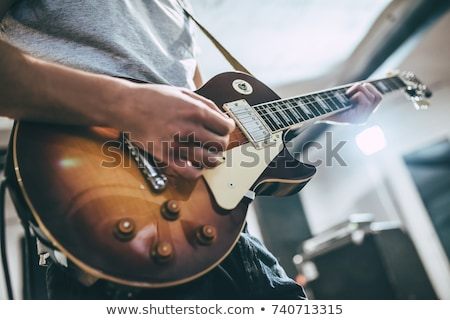 közelkép · gitáros · játszik · akusztikus · gitár · kéz · férfi - stock fotó © sumners