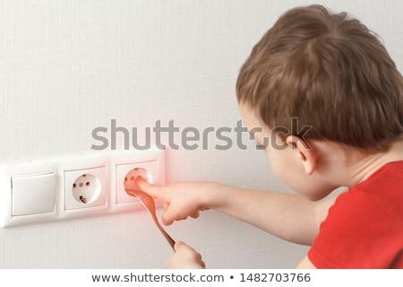 Plug gefährlich Hände Arbeit blau Shirt Stock foto © photography33
