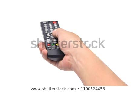 Kéz tart távirányító közelkép kép kék Stock fotó © Ronen