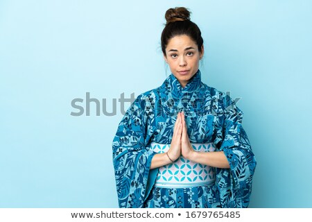 Woman wearing traditional kimono with hands together Stock photo © wavebreak_media