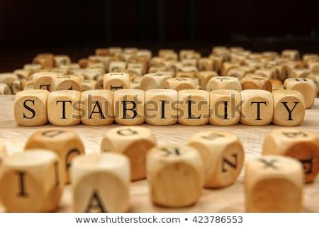 Słowo stabilność złota litery mur tekstury Zdjęcia stock © RomanenkoAlex