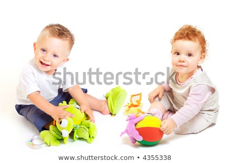 Egyéves baba fiú játszik játékok stúdiófelvétel Stock fotó © dacasdo