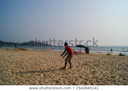 attractive man playing frisby on beach in summer Stock photo © juniart