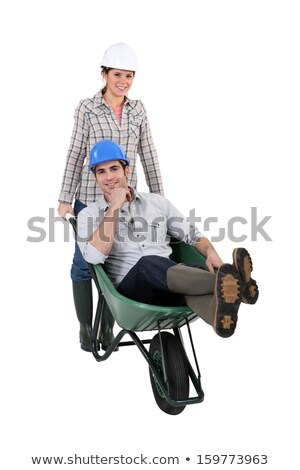 Tradeswoman pushing a wheelbarrow Stock photo © photography33