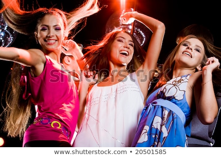 three smiling women dancing in the club stock photo © dolgachov