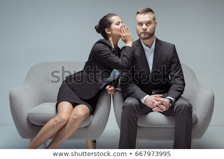 young woman whispers something to man stock photo © feedough