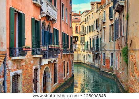 Narrow Canal Among Old Colorful Brick Houses in Venice, Italy Stock photo © anshar