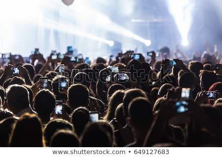 Silhouette of hands taking a photo with mobile phone on a concert Stock photo © jeliva