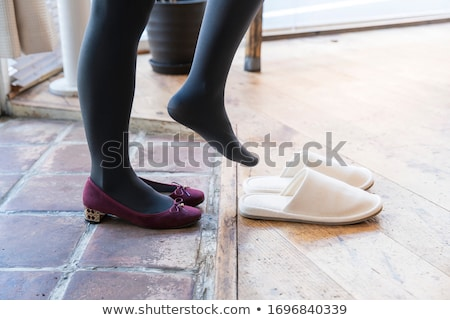 woman taking off shoes stock photo © nyul
