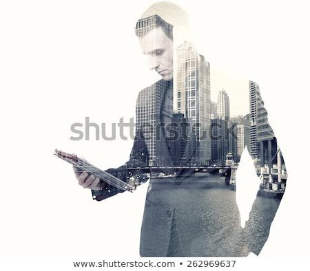 Double exposure of a businessman and a city using a tablet over white background Stock photo © deandrobot