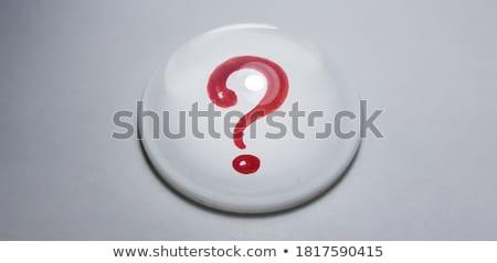 Question sign under paper Stock photo © fuzzbones0