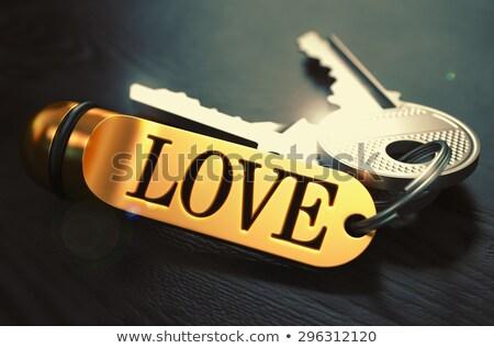 Love - Bunch of Keys with Text on Golden Keychain. Stock photo © tashatuvango