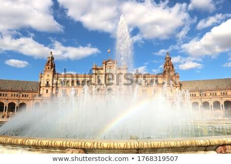 Rainbow at Spain square fountain Stock photo © rmbarricarte