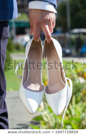 Portrait of young girl with high heel slippers Stock photo © nyul