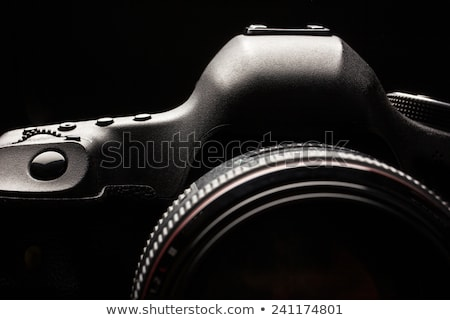 Stock photo: Professional modern DSLR camera low key image