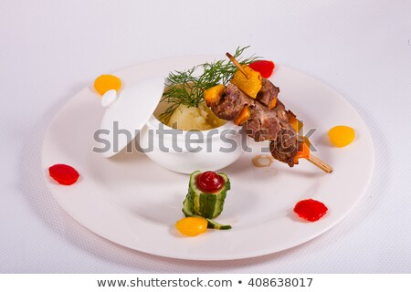 Stock photo: Bacon and potato skewer with mashed potato