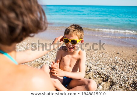 A boy putting his face in the sand Stock photo © bluering