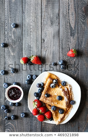 Delicious Crepes Breakfast with Dramatic light over a wood background Stock photo © DavidArts