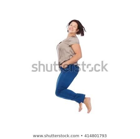 笑みを浮かべて 幸せ プラスサイズ 女性 ジャンプ 高い ストックフォト © dolgachov