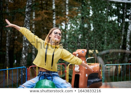 A green carrousel ride Stock photo © bluering