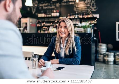 twee · jonge · collega's · koffiepauze · cafe · samen - stockfoto © deandrobot