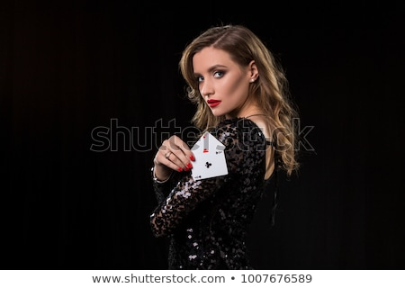 Foto stock: Mulher · jovem · cassino · jogos · de · azar · terno · preto · sucesso