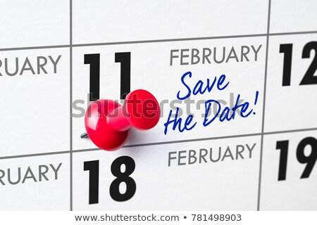 save the date written on a calendar   february 11 stock photo © zerbor