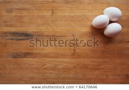 Barna tojás vágódeszka fából készült egy fehér háttér Stock fotó © Digifoodstock