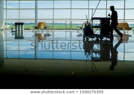 male janitor cleaning the toilet stock photo © bluering