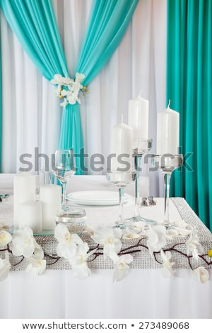 Wedding table decorated with orchids and candlesticks Stock photo © olgaBurtseva