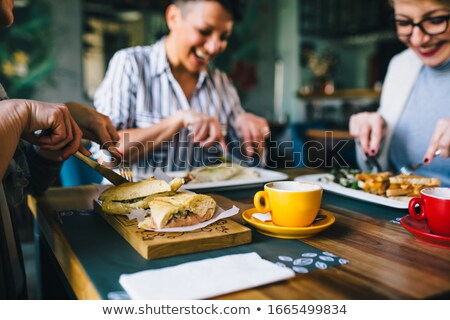 Vertical image of woman in eatery Stock photo © deandrobot