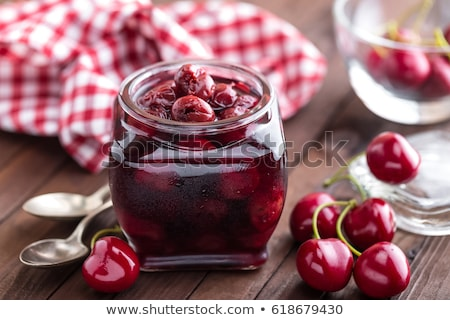 Berries cherry with syrup in a glass jar. Canned fruit Stock photo © yelenayemchuk