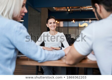 Cheerful lady in office coworking sitting near laptop computer Stock photo © deandrobot