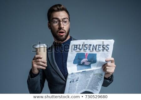 businessman reading a newspaper and drinking coffee in the morni stock photo © kzenon