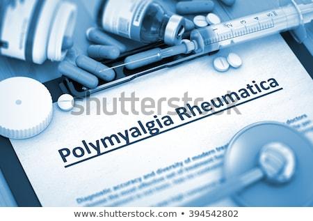Diagnosi medici relazione pillole siringa immagine Foto d'archivio © tashatuvango