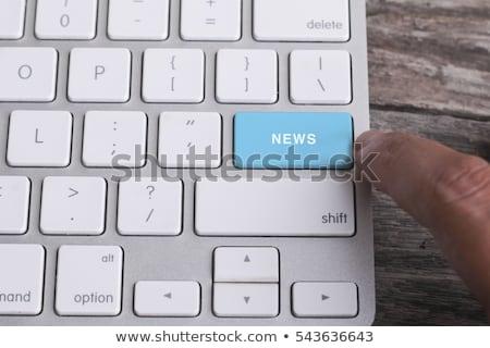 billentyűzet · kék · gomb · rendkívüli · hírek · laptop · billentyűzet · számítógép · billentyűzet - stock fotó © tashatuvango