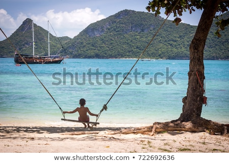 couple lost at sea on little boat stock photo © is2