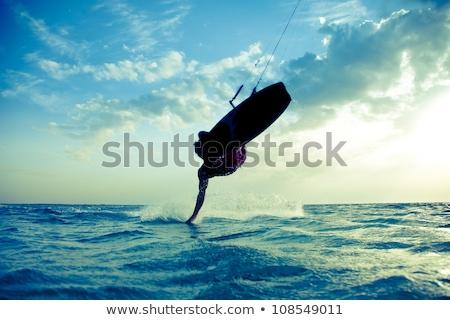 человека прыжки Flying кайт Европа улыбаясь Сток-фото © IS2