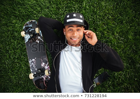 top view of a young african male teenager in earphones stock photo © deandrobot