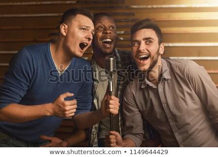 Hombre karaoke bar noche bokeh Foto stock © stevanovicigor