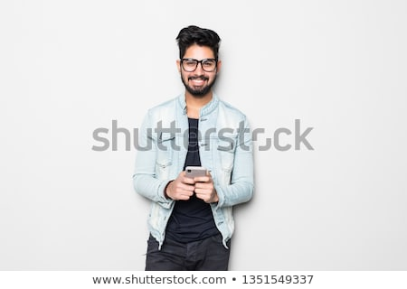 young handsome asian man hipster in glasses on white background stock photo © iordani