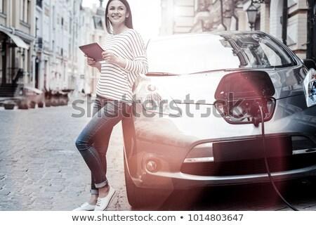 Fille sur voiture électrique femme voiture Photo stock © IS2