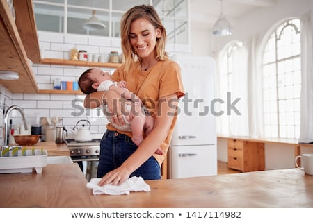 woman busy in kitchen stock photo © is2