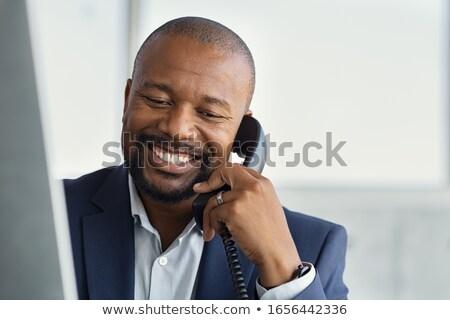 Africano empresário falante telefone óculos corporativo Foto stock © studioworkstock
