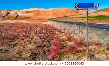 Stock photo: Direction pointer in front of volcanos