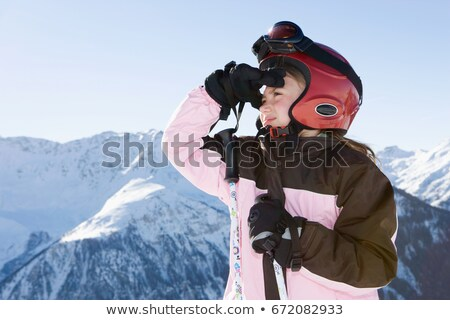 Stock photo: Young girl in ski kit looking at scenery