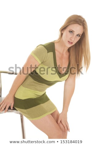 seductive woman wearing a long green dress leans to side Stock photo © feedough