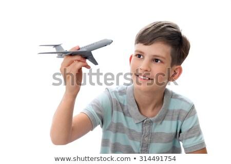 Boy holding toy airplane. Stock photo © iofoto